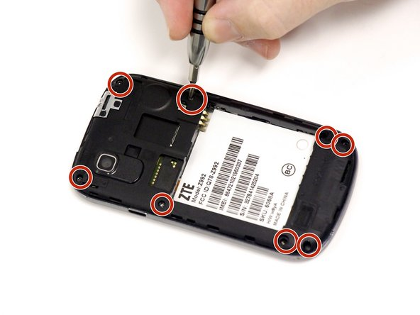 Using your J00 screwdriver, unscrew each of the 8 Philips head 1.19mm screws from the black plate of the device.