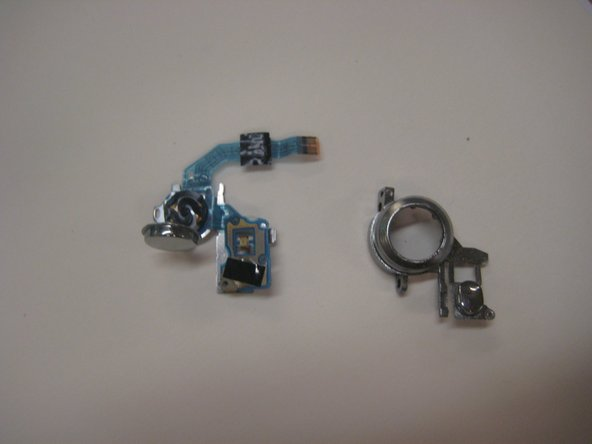 Use a scalpel to pry apart the metal inner part of the button from the plastic outer piece.