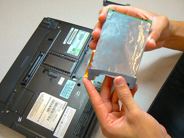 Remove the two gray rubber covers from  both ends of the hard drive.