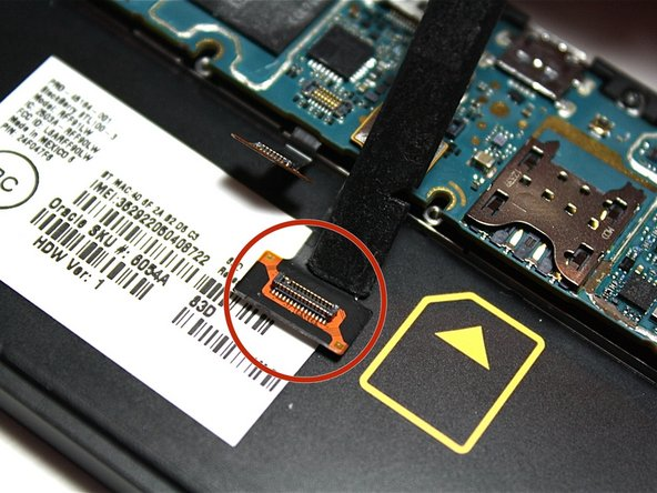 Then, use the nylon spudger to lift up and open the other gold ribbon cable located behind the previous one.