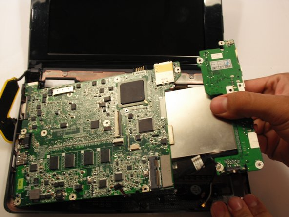 Image 1/1: Pull out the motherboard from its housing.