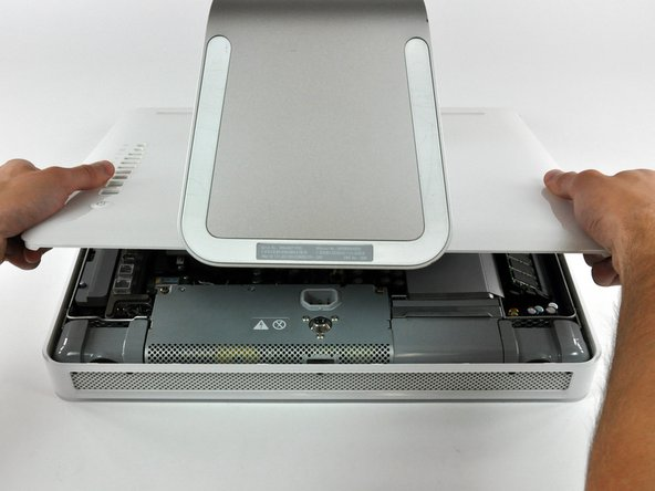 Image 2/3: Pull the rear panel toward yourself and remove it from the iMac.