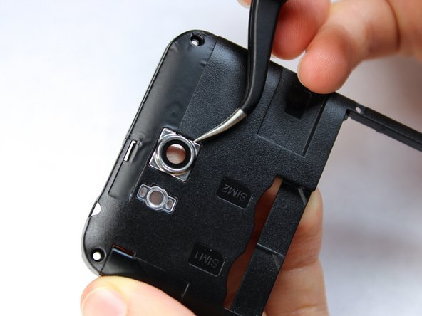 Holding the midframe face-up, locate the camera lens near the top center of the midframe.