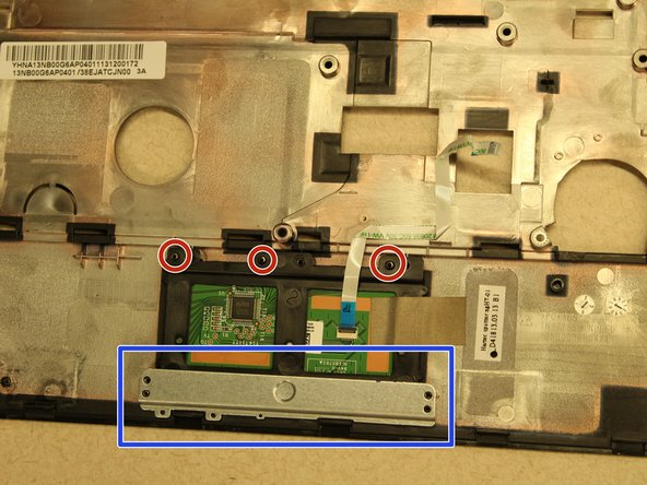Remove the 3mm screws (3) circled in red with a #0 Phillips head screwdriver.
