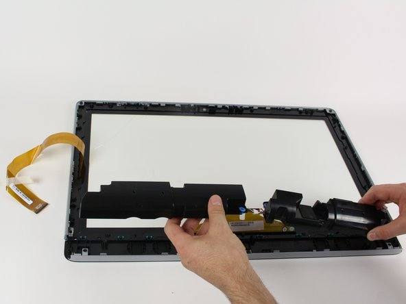 When the speakers are free, use your hands to pull them free from the digitizer.