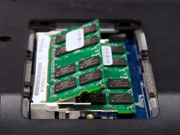 Gently remove the RAM chip from its placement.