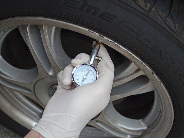 Using a handheld pressure gauge, check the pressure in the tires. The tires should be inflated to approximately 30 psi.