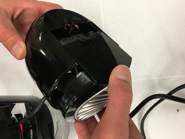 Remove the fan cover using two hands.