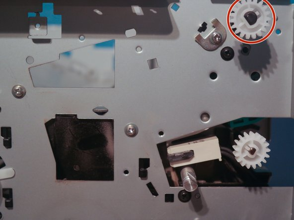 Remove one gear on the output shaft of the fuser.