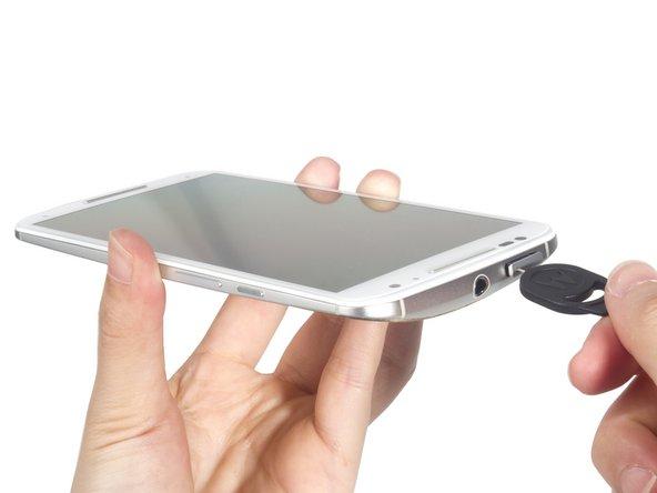 Remove SIM card tray.