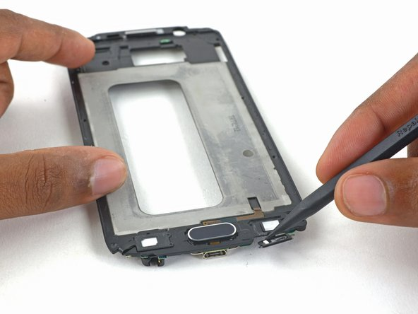 Gently lift the LED cable off the display frame.