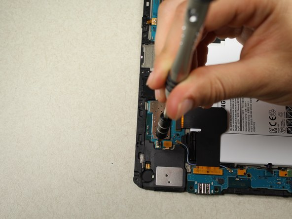 Using the screwdriver, remove the 4  black 3.0 mm Phillips head screws located on the upper and lower motherboard.