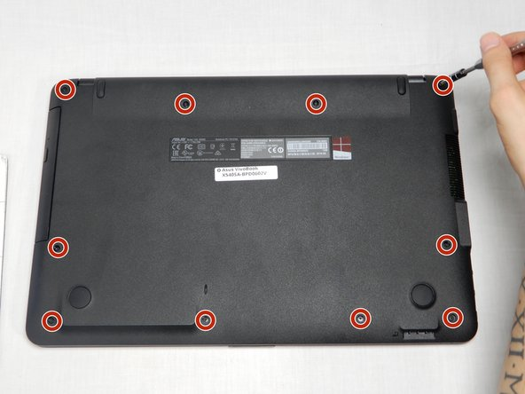 Using the Philips head #1 screwdriver, remove the ten screws from the back panel. Two top corner screws (12cm), two battery screws (15cm), and six case screws (10cm).