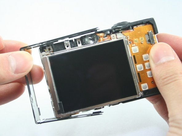 Remove the C-shaped plate from the side of the LCD screen.