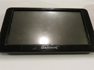 SOLVED: Why wont it turn on? I plug it and it only displays GARMIN