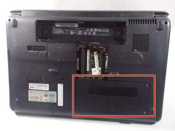 With the battery and RAM removed, locate the hard drive access panel.
