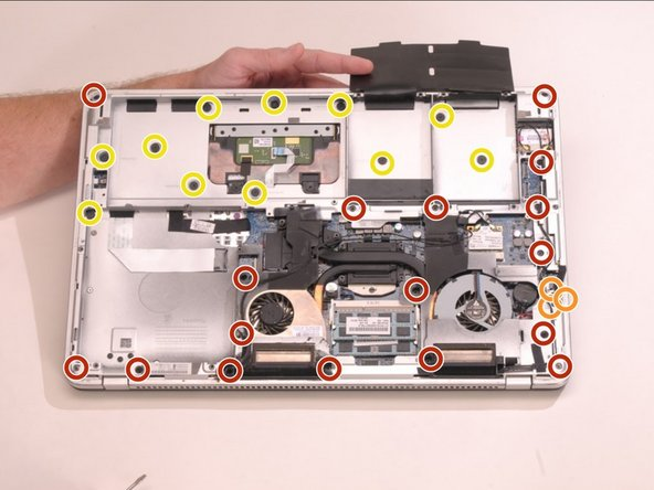 Image 1/1: Remove the three 3.6 mm Phillips screws.