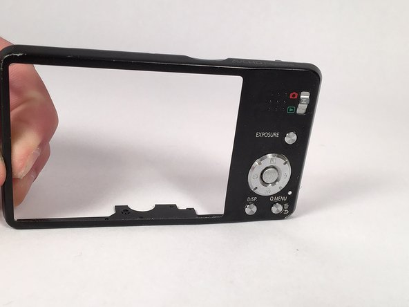 Using the plastic prying tool, remove the cover of the camera that is on the same side as your LCD screen. This cover should come off relatively easily, and will expose the motherboard that the screen is connected to.