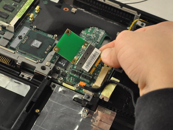 Slide the Wi-Fi card out of its slot to remove.