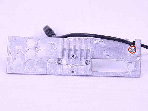 Remove the 3.5mm Phillip #0 screw that secures the USB cable to the back panel.