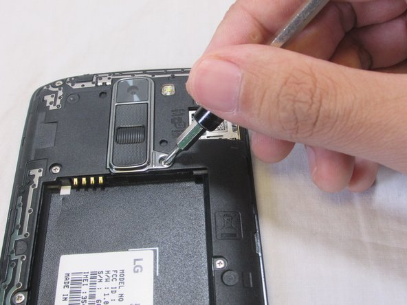 Use a Phillips 00 screwdriver to remove the 3.4 mm screw.