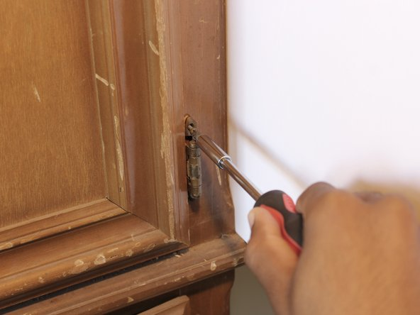 Finally, line up the hinge's holes with the holes from the previous cabinet door.  Then screw the new door on.