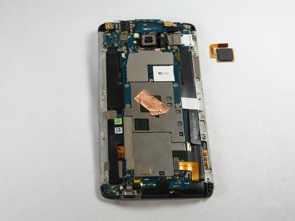 Image 2/2: When replacing the fingerprint sensor, make sure the ribbon cable snaps into the port on the motherboard.