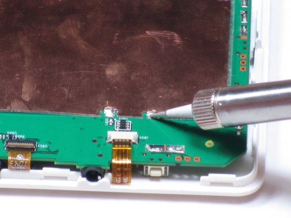The solder point in the bottom right corner is marked but hidden by the soldering iron.