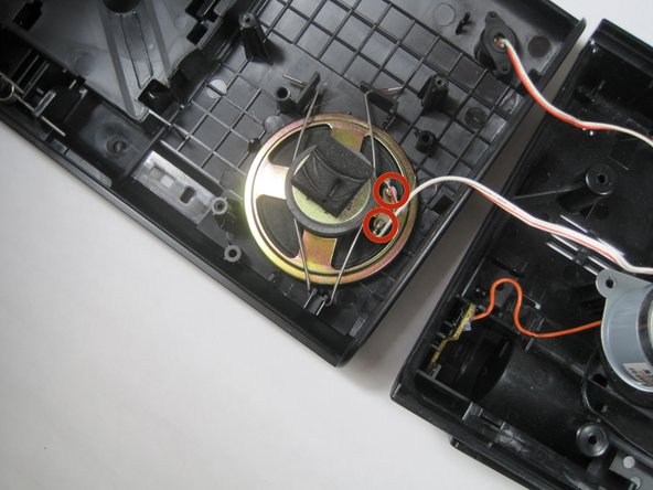 Desolder the two wires from the speaker.