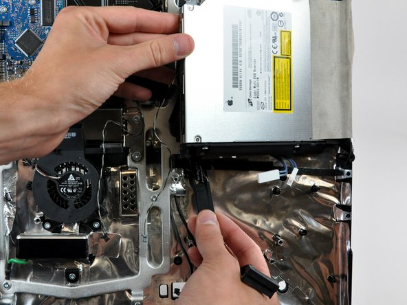 Peel the optical drive data cable off the adhesive securing it to the rear case and remove it from your iMac.