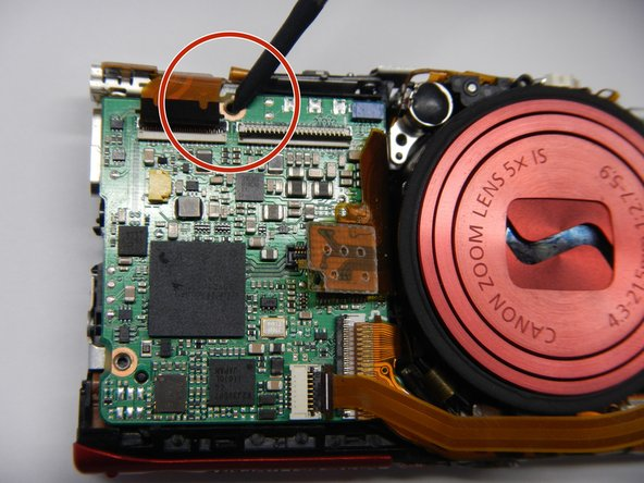 Remove the top screw on the motherboard. (2.5 mm).
