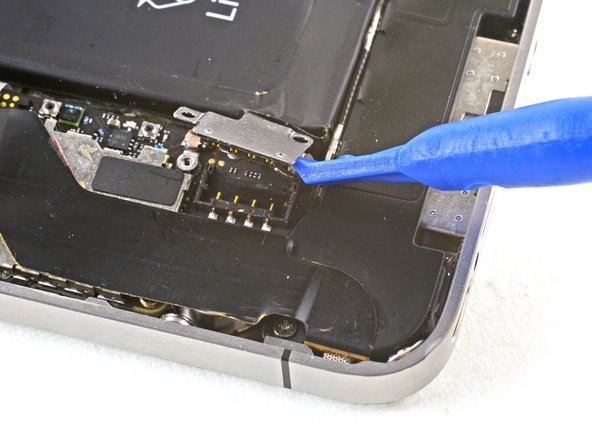 The battery connector comes off vertically from the logic board. Do not apply force sideways.