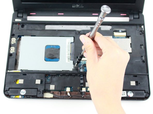 Remove the single 8mm Phillips 0 screw attaching the hard-drive cage to the body of the device.