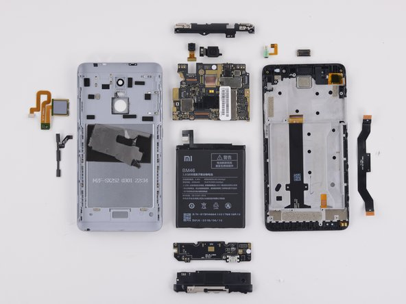 Image 1/2: Despite no external screws, the rear case is fairly easy to remove.