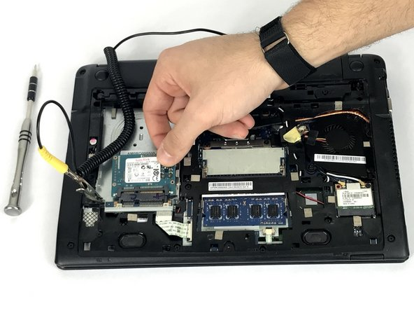 Once all the screws are out, gently pull the hard drive out as pictured.
