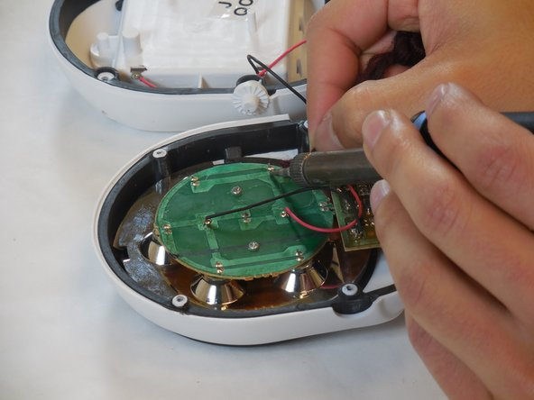 Image 1/1: Using a soldering iron and desoldering braid, unsolder the connection on the light emitting diode.