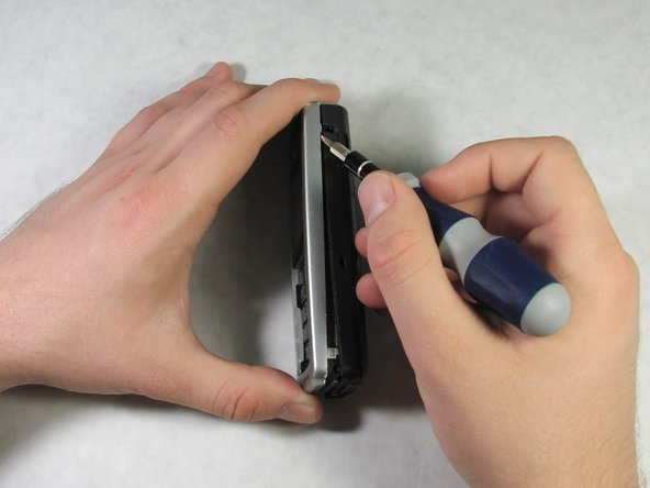 Beginning at this point, slide the head of the screwdriver between the front casing and the rest of the phone.
