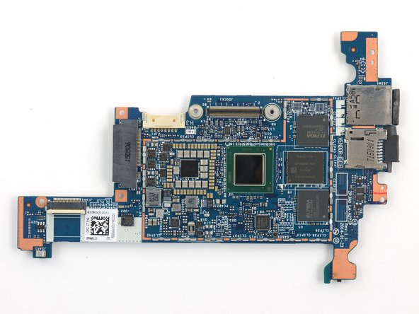 Flipping the motherboard over reveals a pair of screws securing the lower assembly flex cable to the main board.