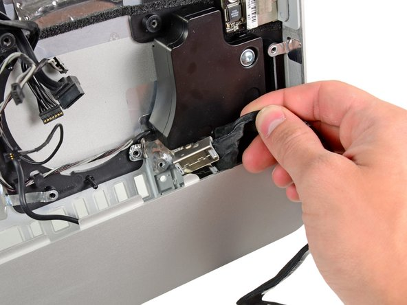 Image 2/2: A pair of tweezers is helpful to put the ports back in place. First insert the lower tab into the bracket on the outer case, then fasten the screw to secure the jack to the outer case.