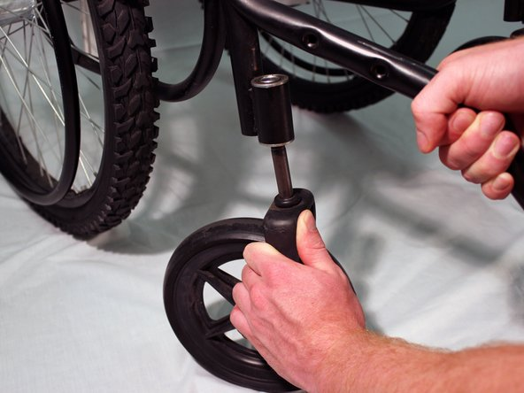 Remove the wheel from the small steel frame