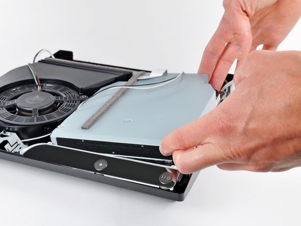 Lift the Blu-ray drive slightly by its right edge to dislodge the control board from its housing.