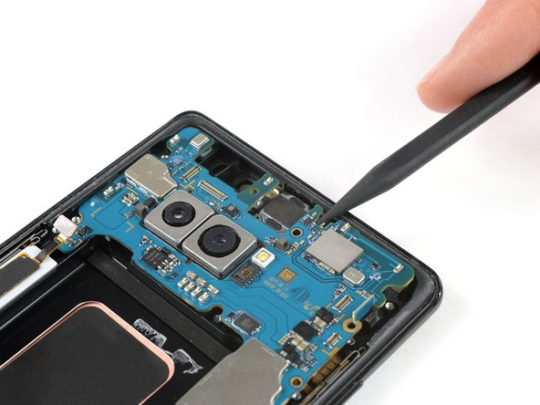 It is possible to remove the motherboard whilst keeping the daughterboard in its place. However the flex connector of the daughterboard sits on the backside of the motherboard and it's a bit of a fumbling to disconnect it while you're  holding the motherboard in your hand.