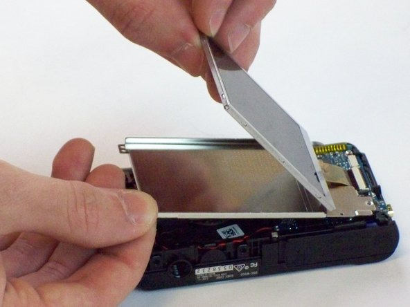 Lift the back panel and separate the LCD Screen by prying it up.