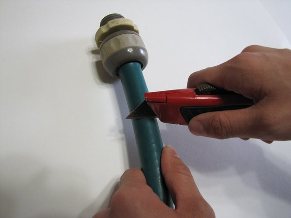 Remove the original broken end by using a utility knife to cut 2-3 inches from the hose.