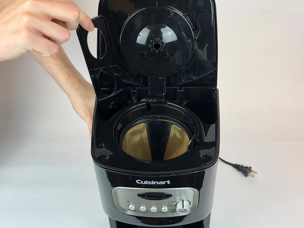 Grab and pull the holder up and out of the coffeemaker.