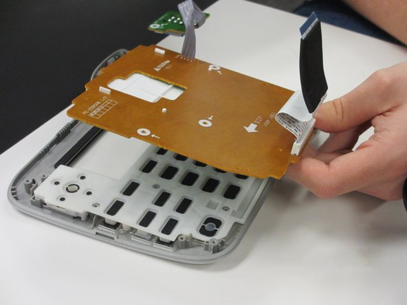 Remove top shell circuit board by lifting the circuit board out of the case