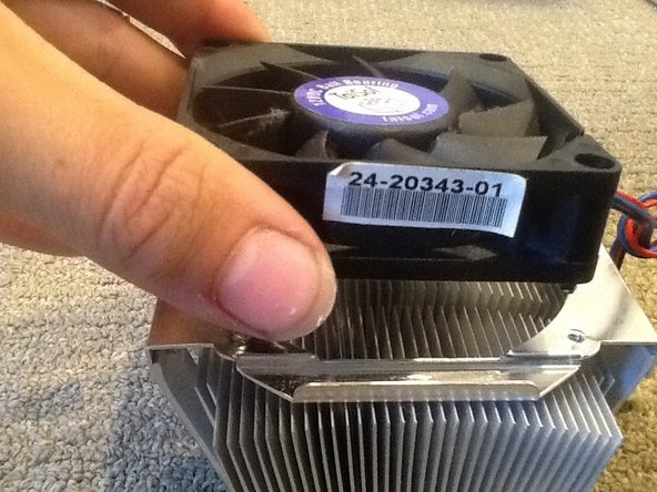 Remove the four screws from the heatsink fan and remove the fan.