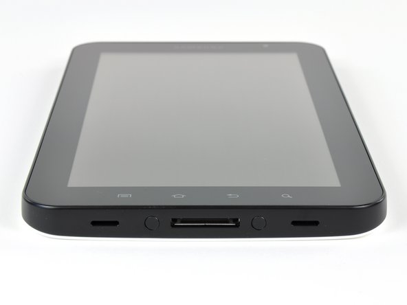 Image 1/2: The Galaxy Tab has ports for headphones, the sim card, microSD (support for up to 32 GB), and a USB dock connector.