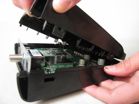 Continue pulling until you have completely removed the top cover of the device.