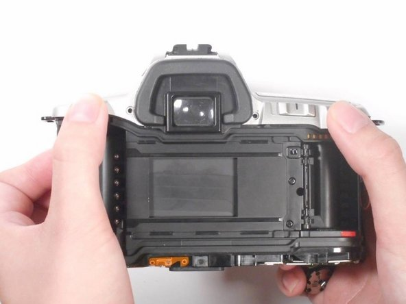 The top panel of the camera should now be easy to pop off. If it is not, make sure that all screws listed in steps 3-9 are removed.